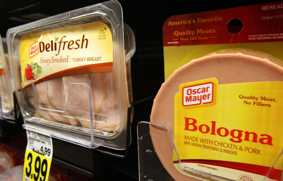 FILE - In this Feb. 9, 2012 file photo, a traditional package of Oscar Mayer bologna is seen alongside the brand's Delifresh honey smoked turkey, all part of the Kraft Foods Inc. family of brands and products, are seen at a Ralphs Fresh Fare supermarket in Los Angeles. Kraft Foods Inc. said Tuesday, Feb. 21, 2012, its fourth-quarter net income rose 54 percent as its price increases helped offset higher costs. (AP Photo, File)