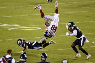 New York Giants' Evan Engram (88) tumbles after trying to leap over Philadelphia Eagles' Cre'Von LeBlanc (34) as Josh Sweat (94) defends during the second half of an NFL football game, Thursday, Oct. 22, 2020, in Philadelphia. (AP Photo/Derik Hamilton)