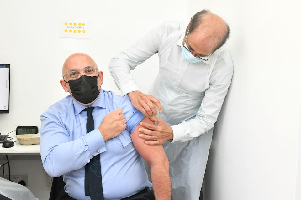 Nadhim Zahawi (left), Minister for Covid Vaccine Deployment, with pharmacist Salim Jetha, as he receives his second dose of the COVID-19 vaccination at Lewisham Grove Pharmacy, south-east London. Picture date: Tuesday June 8, 2021.