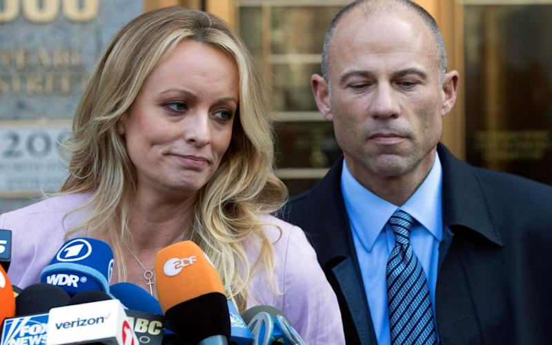 Stormy Daniels with her former lawyer Michael Avenatti speaking outside a court in New York - AP