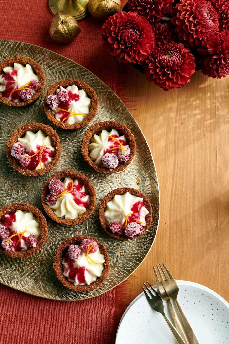 "<p><strong>Recipe: <a href=""https://www.southernliving.com/recipes/mini-cranberry-cheesecake-pies"" rel=""nofollow noopener"" target=""_blank"" data-ylk=""slk:Mini Cranberry-Cheesecake Pies"" class=""link rapid-noclick-resp"">Mini Cranberry-Cheesecake Pies</a></strong></p> <p>These festive little bites adorned many of our readers' Thanksgiving tables, and one even said ""everyone should make them."" Sugared cranberries and a touch of orange zest are the prettiest toppings.</p>"
