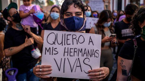 PHOTO: A woman member of a feminist collective holds a sign that reads in Spanish 'I Want My Sisters Alive' during a demonstration against sexual violence in front of the governor's mansion in San Juan, Puerto Rico. May 3, 2021. (Ricardo Arduengo/AFP via Getty Images)