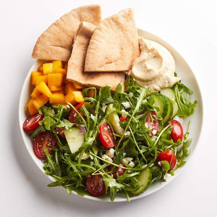 <p>Tomatoes, cucumber, red onion and feta top arugula in this quick Greek salad. Served with whole-wheat pita and prepared hummus, it makes a filling, yet healthy lunch.</p>