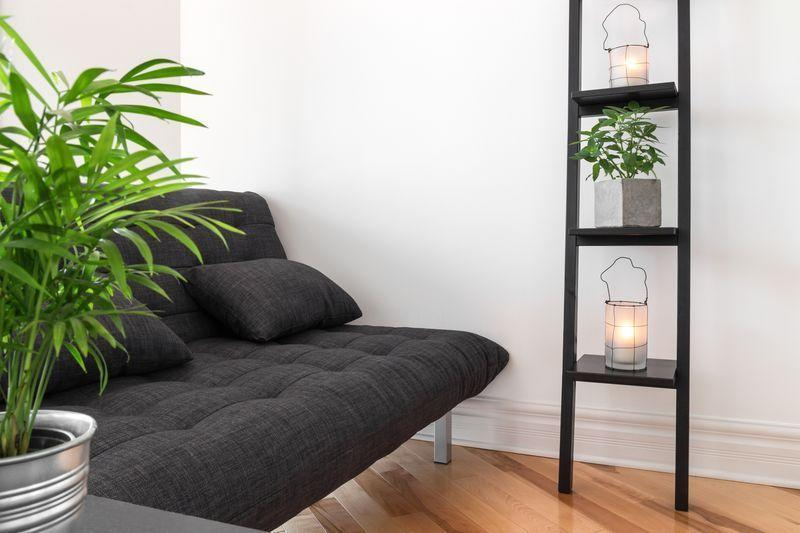 <p>If you're past the age of 18, there's no reason to outfit any room in your home with a futon. Stay away from the dorm room look and opt for a traditional sofa style such as a loveseat.</p>