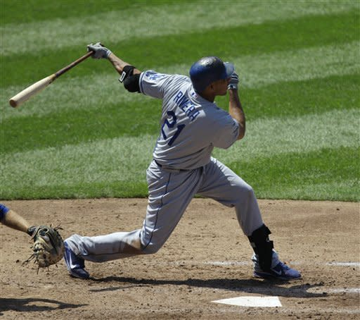 Los Angeles Dodgers' Juan Rivera (21) hits a fourth-inning two-run home run off New York Mets starting pitcher Jonathon Niese in their baseball game at Citi Field in New York, Sunday, July 22, 2012. (AP Photo/Kathy Willens)