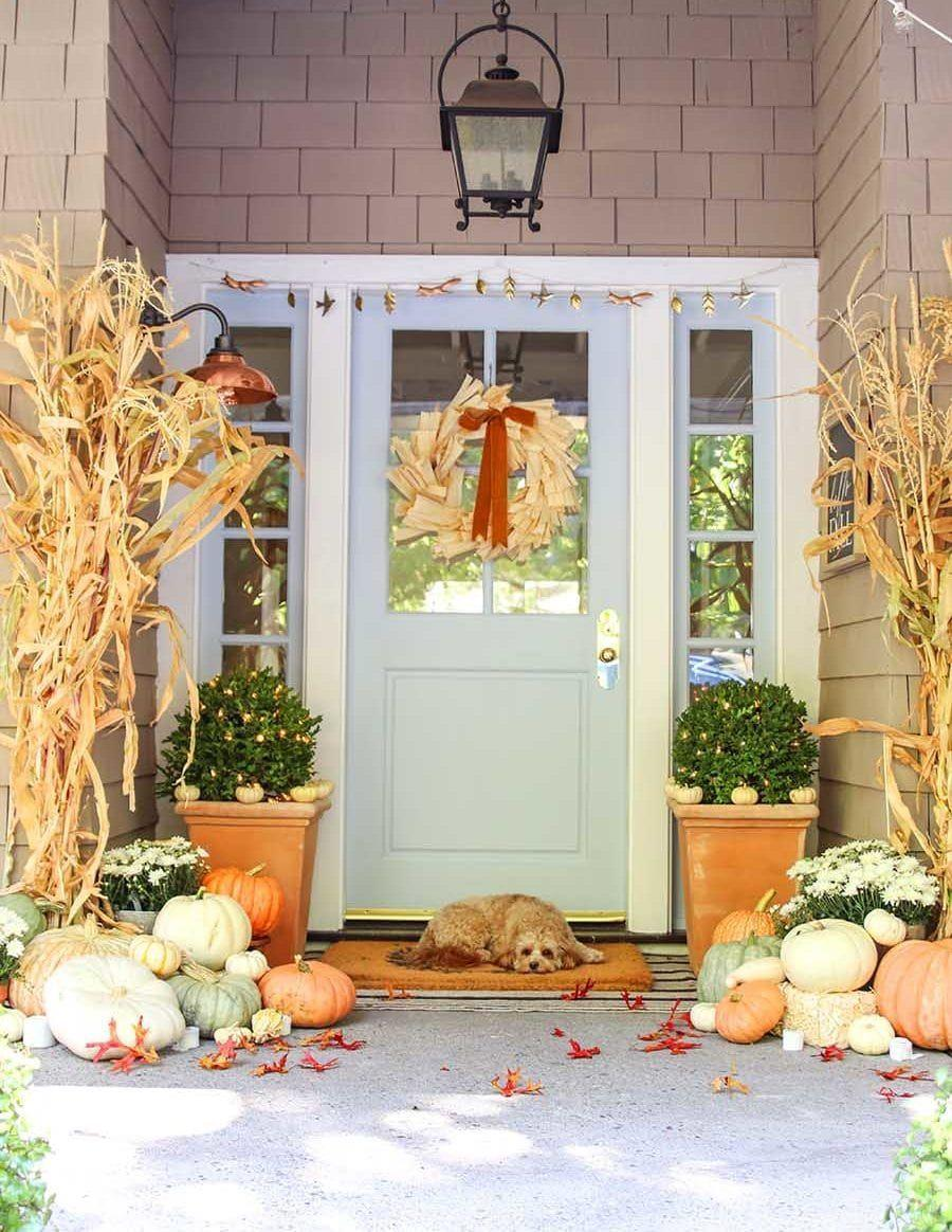 """<p>Not one for black and bright orange? Luckily for you, pumpkins and gourds come in a variety of colors, including earthy pastels. </p><p><strong>See more at <a href=""""https://www.modern-glam.com/neutral-fall-porch-pumpkins-cornstalks/"""" rel=""""nofollow noopener"""" target=""""_blank"""" data-ylk=""""slk:Modern Glam"""" class=""""link rapid-noclick-resp"""">Modern Glam</a>. </strong></p><p><a class=""""link rapid-noclick-resp"""" href=""""https://www.amazon.com/Offray-Berwick-Double-Ribbon-Sienna/dp/B007HL4JMU?tag=syn-yahoo-20&ascsubtag=%5Bartid%7C2164.g.36877187%5Bsrc%7Cyahoo-us"""" rel=""""nofollow noopener"""" target=""""_blank"""" data-ylk=""""slk:SHOP BURNT ORANGE RIBBON""""><strong>SHOP BURNT ORANGE RIBBON</strong></a></p>"""