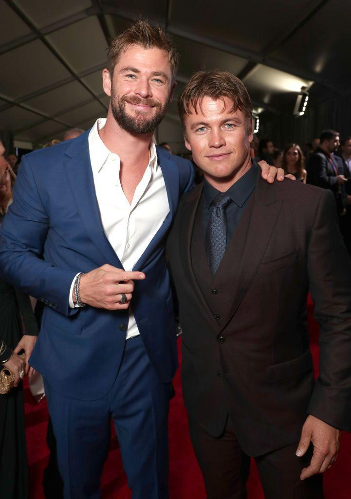 """<p>Luke is far from being """"short,"""" but standing next to his brother Chris (6' 3""""), yeah, he's looking a little tiny. The God of Thunder will do that to you. </p>"""
