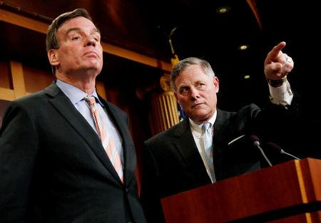 FILE PHOTO --  Senate Intelligence Committee Chairman Sen. Richard Burr, accompanied by Senator Mark Warner, vice chairman of the committee, speaks at a news conference to discuss their probe of Russian interference in the 2016 election on Capitol Hill in