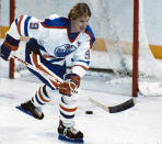 FILE - Edmonton Oilers' star Wayne Gretzky is seen in action, in this 1984 file photo. Alex Ovechkin starts a new five-year contract ready to chase Wayne Gretzky's career goals record that long seemed unbreakable. The Washington Capitals captain has 730 goals and needs 165 to pass Gretzky. (Canadian Press via AP, File)