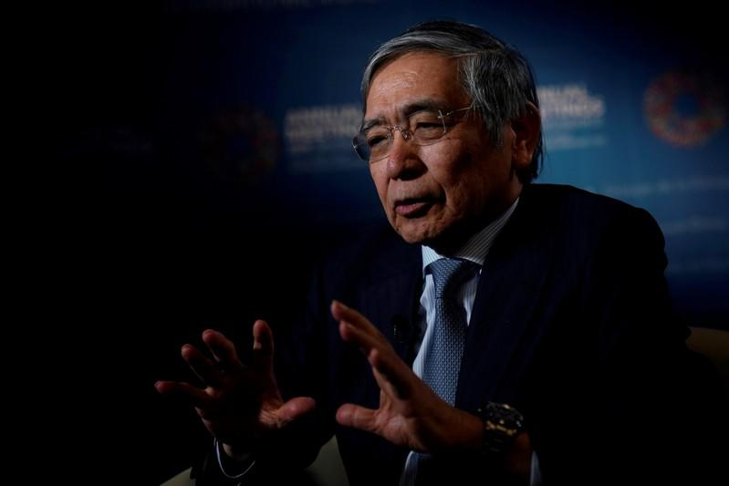 FILE PHOTO: Bank of Japan (BOJ) Governor Haruhiko Kuroda, speaks during an interview with Reuters in Washington