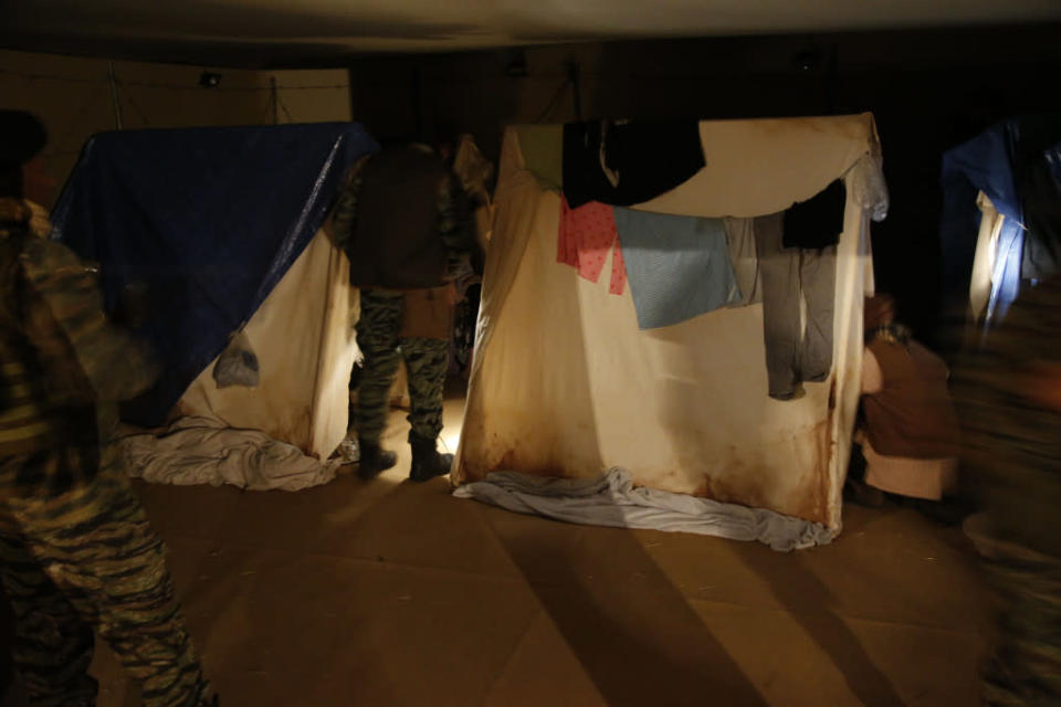 Participants wait in their tents at 'nighttime' in the camp at A Day in the Life of a Refugee.