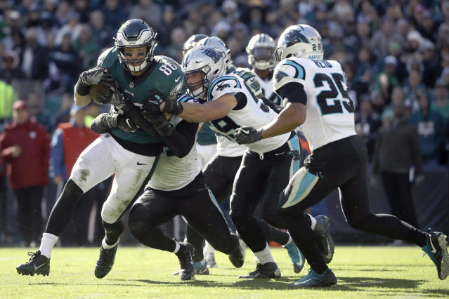 Eagles tight end Zach Ertz is tackled by a host of Carolina Panthers defenders. (AP)