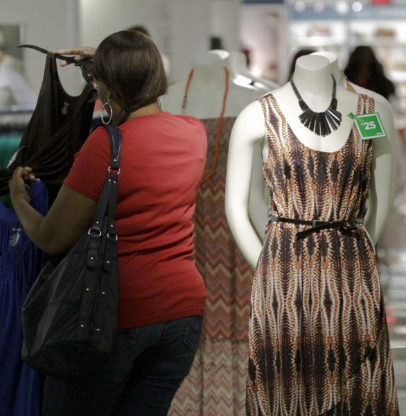 In this June 8, 2012 photo, a dress display with a green tag item price for the month of June is displayed at a J.C. Penney store in New York. Six months after J.C. Penney got rid of the hundreds of sales it offers each year in favor of a three-tier pricing approach, the mid-priced department store chain is revamping its pricing strategy again. (AP Photo/Bebeto Matthews)