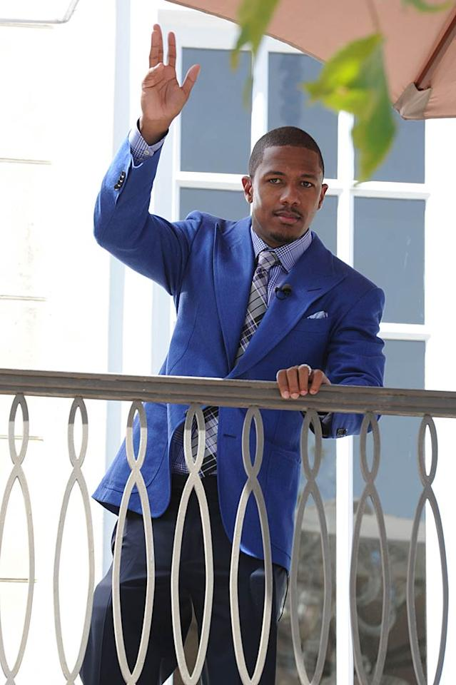 """New dad Nick Cannon gave his fans a wave while at The Grove. Think he pick up anything for his and Mariah Carey's new twins, Monroe and Moroccan? Whittle/<a href=""""http://www.gettyimages.com/"""" target=""""new"""">GettyImages.com</a> - July 12, 2011"""