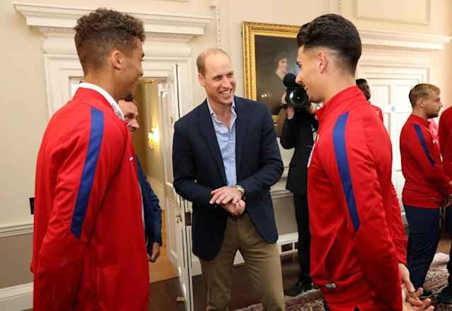 LONDON, ENGLAND - SEPTEMBER 07: Prince William, Duke of Cambridge (C) President of the Football Association, speaks with Dominic Calvert-Lewin (L) and Luke Southwood (R) during a reception for the Under-20 England Football Team at Kensington Palace on September 7, 2017 in London, England. The England Under-20 side became the first England team to win a football World Cup since 1996 when they beat Venezuela 1-0 on June 11th, 2017. (Photo by Chris Jackson - WPA Pool/Getty Images)