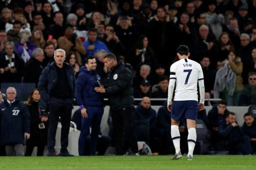 Son Heung-min trudges off after receiving a red card for his challenge on Chelsea's Antonio Rudiger