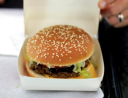 FILE PHOTO: An employee prepares to serve a burger at a fast food restaurant in Nice, France
