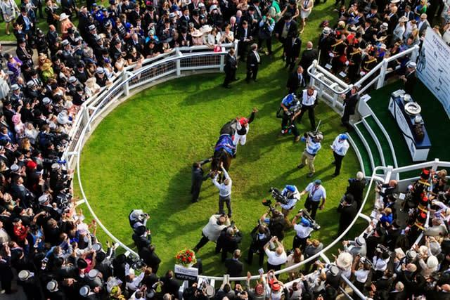 Frankie Dettori leaps from Golden Horn in the winner's enclosure after victory in the 2015 Derby at Epsom. His 20th Derby ride brought a second victory in the race for Italian-born rider Dettori, who triumphed for the first time at the 15th attempt on Authorized in 2007 (John Walton/PA)