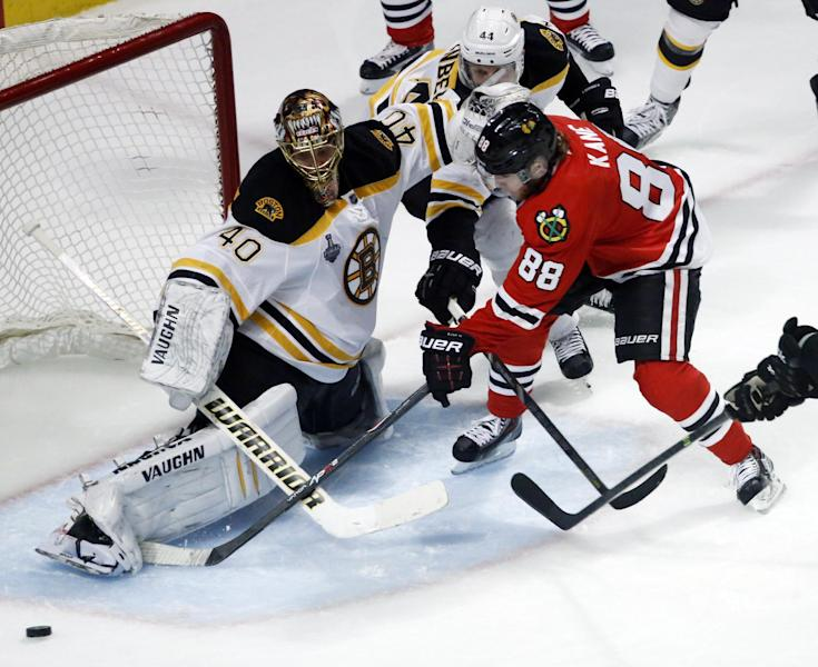 Boston Bruins goalie Tuukka Rask (40) makes a save on a shot by Chicago Blackhawks right wing Patrick Kane (88) during the second overtime period of Game 1 in their NHL Stanley Cup Final hockey series,Wednesday, June 12, 2013 in Chicago. (AP Photo/Charles Rex Arbogast)