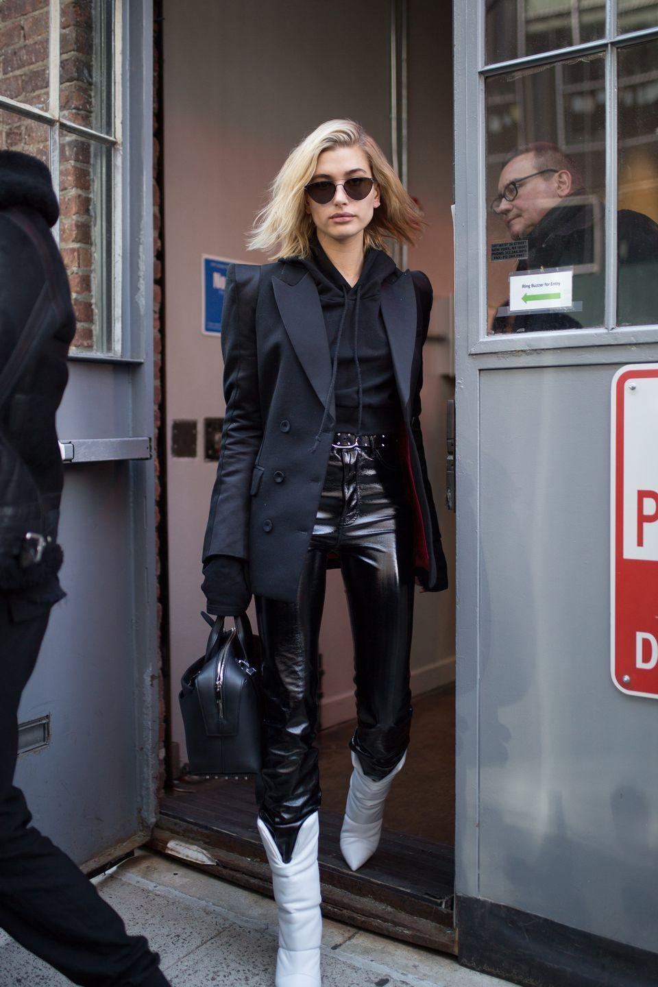 <p><em>This </em>is how to wear all black. A structured blazer, slouchy hoodie, and patent leather pants combined offer the perfect mix of texture. The contrast of laid-back and ultra polished gives this look such a fashion feel.  </p>