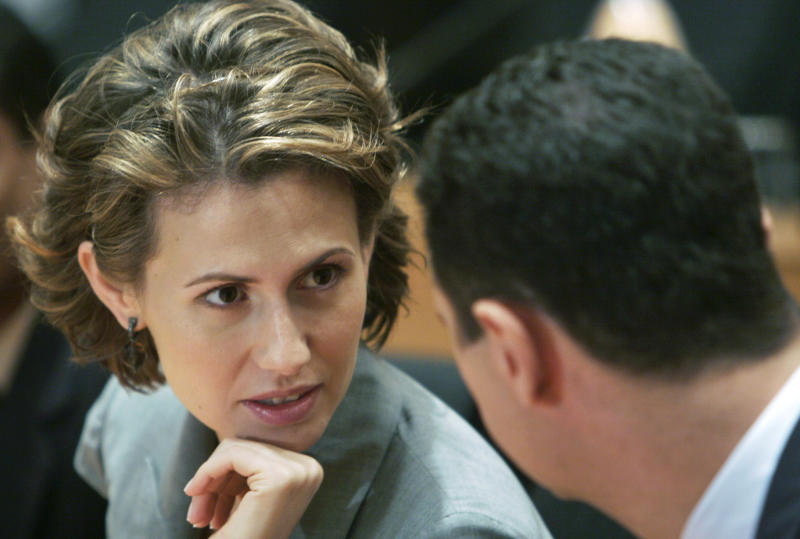 FILE - In this Friday, June 20, 2008 file photo, Syrian President Bashar Assad, right, listens to his wife Asma Assad during their visit to the campus of Infosys Technologies Ltd., an Indian software services company, in Bangalore, India. Assad, the president's British-born wife, is known more for her expensive tastes and glamorous appearance than her political influence, but the EU listed her among the Syrians against whom it has imposed sanctions. (AP Photo/Aijaz Rahi, File)