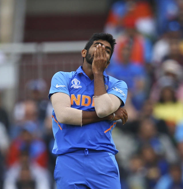 India's Jasprit Bumrah reacts after a drop catch by teammate Mahendra Singh Dhoni during the Cricket World Cup semifinal match between India and New Zealand at Old Trafford in Manchester, England, Tuesday, July 9, 2019. (AP Photo/Dave Thompson)