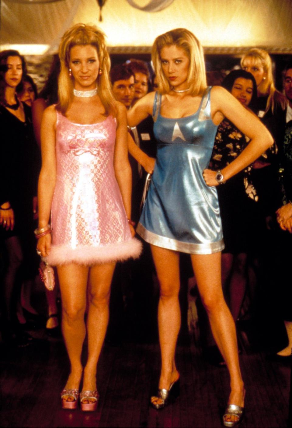 """<p>To dress as our favorite '90s besties from <a href=""""https://www.popsugar.com/love/Romy-Michele-High-School-Reunion-GIFs-28579360"""" class=""""link rapid-noclick-resp"""" rel=""""nofollow noopener"""" target=""""_blank"""" data-ylk=""""slk:Romy and Michele's High School Reunion"""">Romy and Michele's High School Reunion</a>, you need shiny, short dresses; chokers; platform shoes; and sweet dance moves.</p>"""