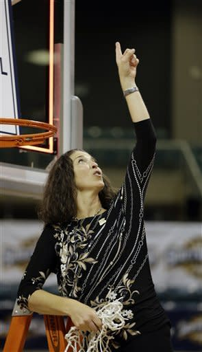 Oral Roberts coach Misti Cussen points to the sky after cutting down the net while celebrating winning the Southland Conference championship basketball game against Sam Houston Saturday, March 16, 2013, in Katy, Texas. Oral Roberts beat Sam Houston 72-66. (AP Photo/David J. Phillip)