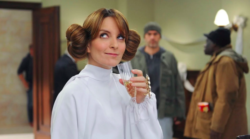 """<p>In true Liz Lemon fashion, she wore a <em>Star Wars</em> get-up, including hair buns that would make Princess Leia proud, to wed Criss Chros in season 7. Apparently, <a href=""""https://www.youtube.com/watch?v=0uakaPT7Slk"""" rel=""""nofollow noopener"""" target=""""_blank"""" data-ylk=""""slk:it was the only white dress she had"""" class=""""link rapid-noclick-resp"""">it was the only white dress she had</a>. </p>"""