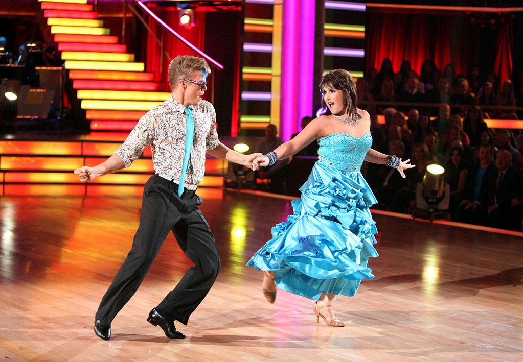 """Talk show titan Ricki Lake paired a bright blue prom bomb with matching eye shadow and an unfortunate mullet while dancing a foxtrot to """"Easy Lover"""" with pro partner Derek Hough during Week 5."""