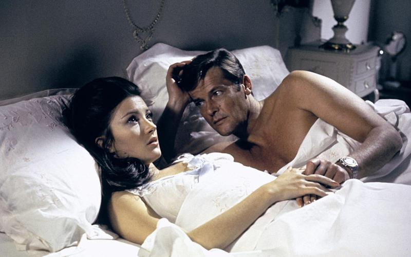 Jane Seymour and Roger Moore in James Bond: Live and Let Die in 1973 - www.Alamy.com