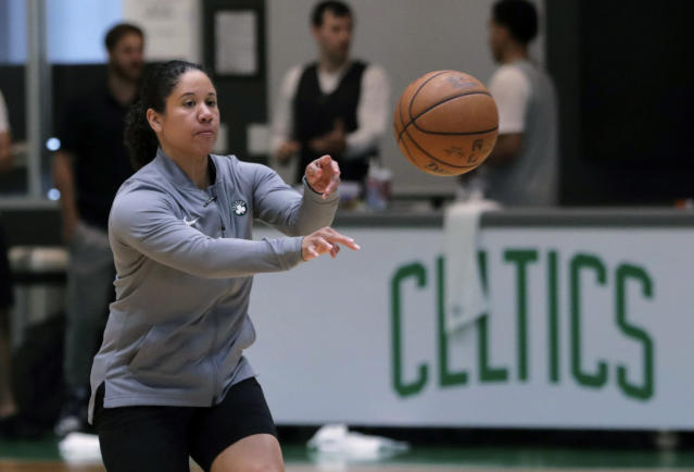 FILE - In this July 1, 2019, file photo, Boston Celtics assistant coach Kara Lawson passes the ball at the team's training facility in Boston. Celtics guard Gordon Hayward said Lawson has already made her presence felt. Shes been good as far as just the experience she has as a basketball player, Hayward said. Reading the game and kind of little things she sees coaching on the sideline. Having somebody that well-versed in basketball, that experience is good. (AP Photo/Charles Krupa, File)