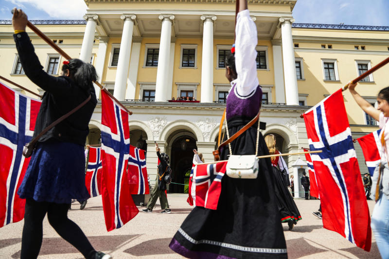 The Norwegian Crown Prince Haakon, Prince Sverre Magnus, Princess Ingrid Alexandra, Crown Prince Mette Marit Queen Sonja, and King Harald wave from the balcony at the Royal Palace in Oslo, as school children parade to mark the Norwegian Constitutional Day on May 17, 2019. (Photo by Berit ROALD / NTB scanpix / AFP) / Norway OUT (Photo credit should read BERIT ROALD/AFP/Getty Images)