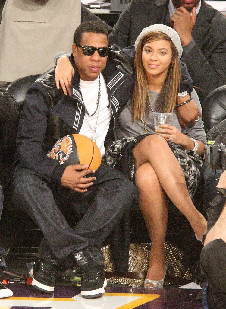 <p>The couple sat arm in arm watching the NBA all star game in Phoenix, Arizona.</p>
