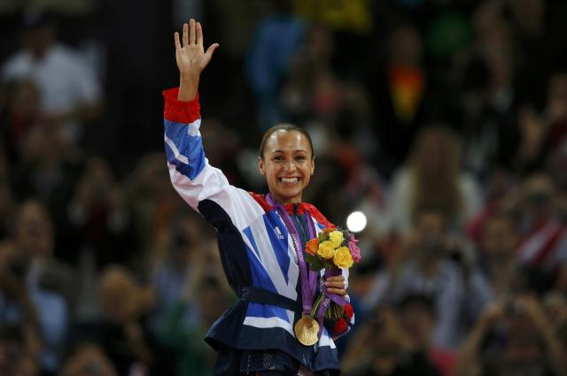Britain's Jessica Ennis waves to the crowd after receiving her gold medal during the women's heptathlon victory ceremony at the London 2012 Olympic Games at the Olympic Stadium August 4, 2012. REUTERS/Phil Noble (BRITAIN - Tags: SPORT ATHLETICS OLYMPICS TPX IMAGES OF THE DAY) Picture Supplied by Action Images PLEASE NOTE: FOR EDITORIAL USE ONLY