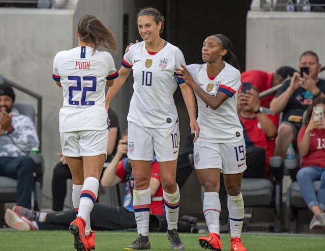 "<a class=""link rapid-noclick-resp"" href=""/olympics/rio-2016/a/1124307/"" data-ylk=""slk:Carli Lloyd"">Carli Lloyd</a> (10) is congratulated by <a class=""link rapid-noclick-resp"" href=""/olympics/rio-2016/a/1124354/"" data-ylk=""slk:Mallory Pugh"">Mallory Pugh</a> (left) and <a class=""link rapid-noclick-resp"" href=""/olympics/rio-2016/a/1124213/"" data-ylk=""slk:Crystal Dunn"">Crystal Dunn</a> after scoring in the USWNT's victory over Belgium on Sunday. (Getty)"