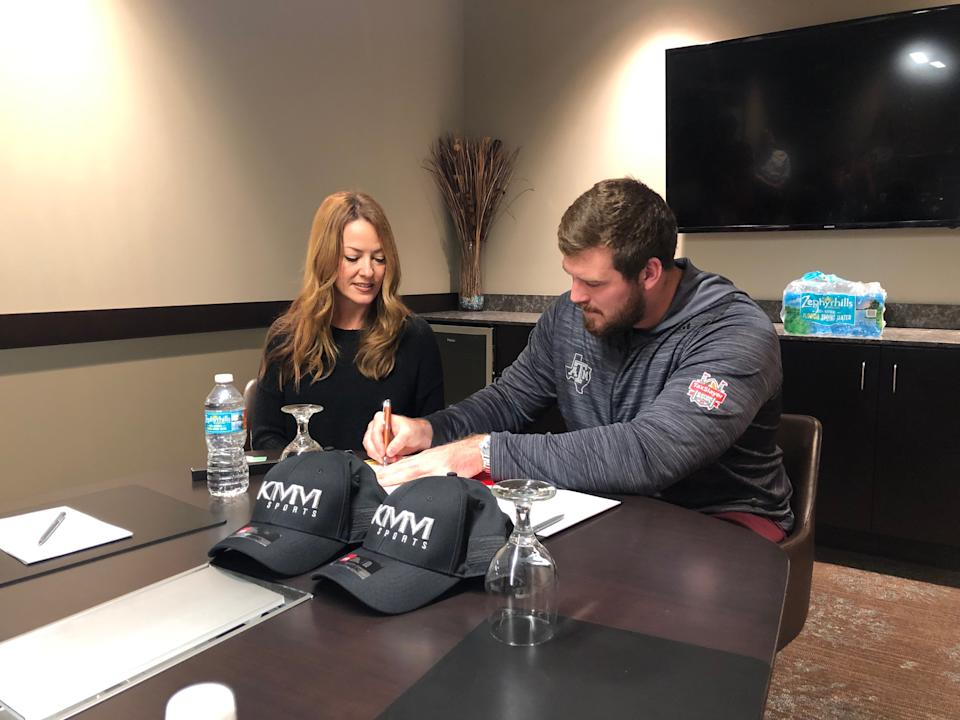 Kelli Masters, pictured with Texas A&M's Keaton Sutherland who signed with the Bengals, runs her own sports agency.