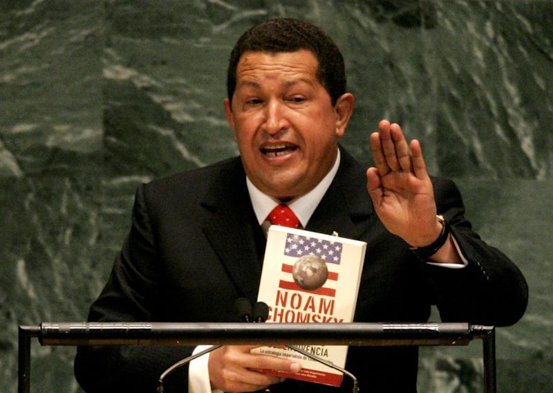 Venezuelan President Hugo Chavez holds a Spanish language version of Hegemony or Survival: America's Quest for Global Dominance by Noam Chomsky while addressing the United Nations General Assembly Sept. 20, 2006.