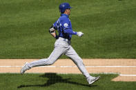 Kansas City Royals' Whit Merrifield runs to first after hitting a one-run single against the Chicago White Sox during the first inning of a baseball game in Chicago, Sunday, Aug. 30, 2020. (AP Photo/Nam Y. Huh)