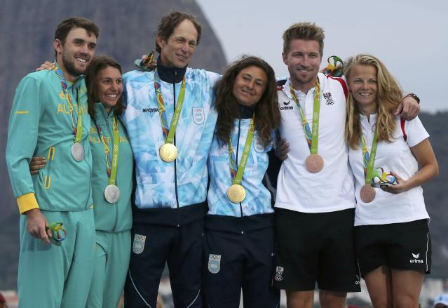 2016 Rio Olympics - Sailing - Victory Ceremony - Mixed Multihull - Nacra 17 - Victory Ceremony - Marina de Gloria - Rio de Janeiro, Brazil - 16/08/2016. Jason Waterhouse (AUS) of Australia and Lisa Darmanin (AUS) of Australia, Santiago Lange (ARG) of Argentina and Cecilia Carranza (ARG) of Argentina and Thomas Zajac (AUT) of Austria and Tanja Frank (AUT) of Austria pose with their medals. REUTERS/Benoit Tessier FOR EDITORIAL USE ONLY. NOT FOR SALE FOR MARKETING OR ADVERTISING CAMPAIGNS.