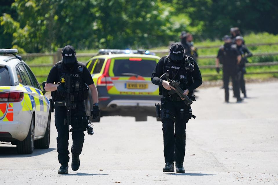 Armed police at Hallington House (PA Wire)