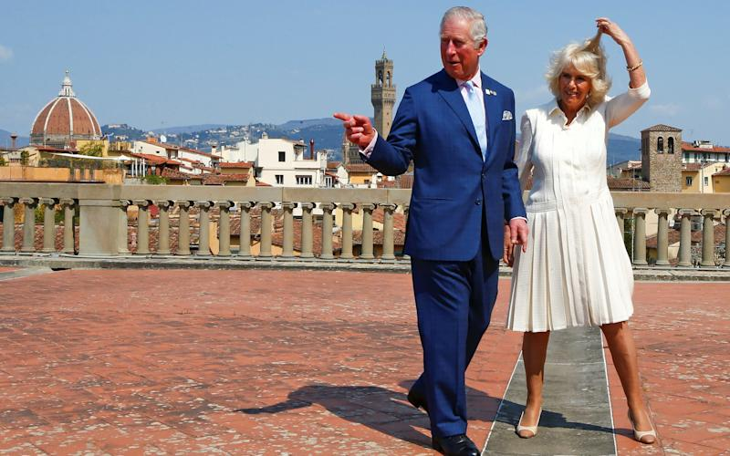 Britain's Prince Charles and his wife Camilla, Duchess of Cornwall pose at Pitti Palace in downtown Florence - Credit: REUTERS/Tony Gentile