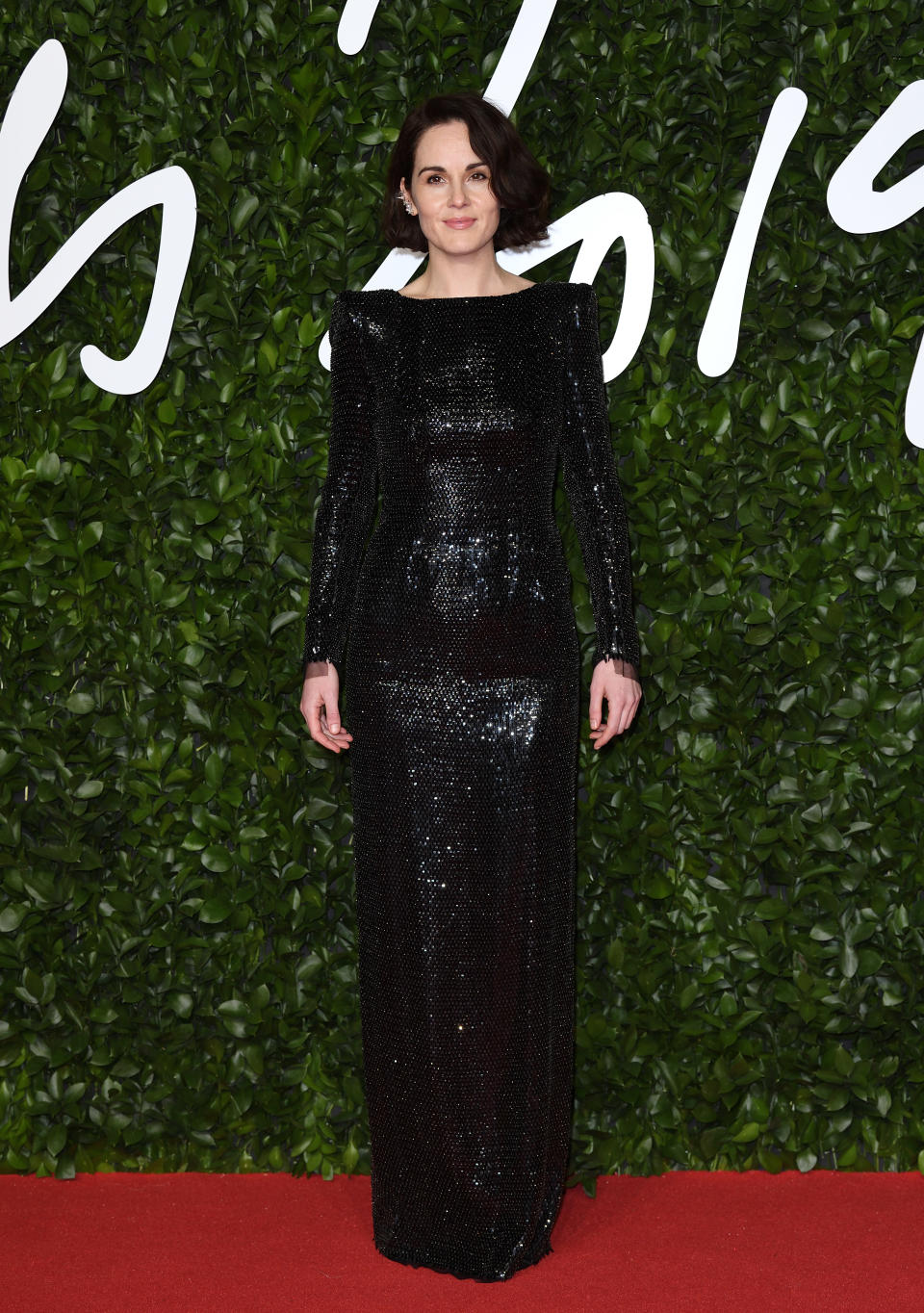 Michelle Dockery added subtle sparkle in this floor length gown [Photo: Getty]