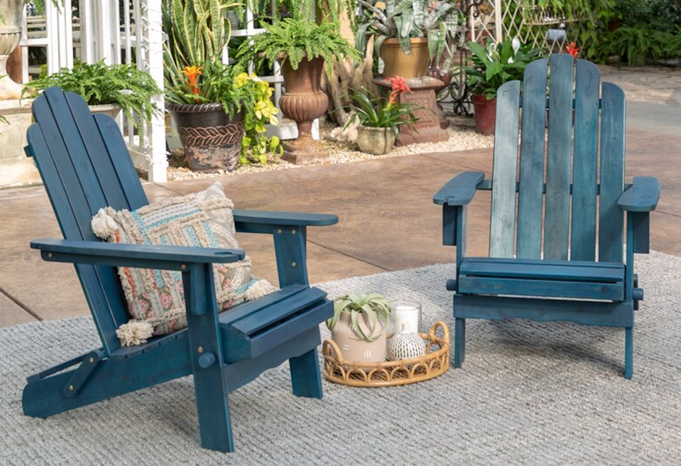 Classic Adirondack chairs in weathered navy will give your yard the perfect pop of color. (Photo: All Modern)