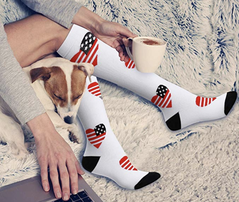 These unisex compression socks have more than 6,000 reviews — and I swear by them for relief from my desk job. (Photo: Amazon)