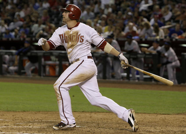 FILE - In this July 19, 2010, file photo, Arizona Diamondbacks' Mark Reynolds watches his three-run home run against the New York Mets during the sixth inning of a baseball game in Phoenix. Reynolds is retiring after hitting 298 homers over 13 seasons with eight teams. The 36-year-old made the announcement Thursday, April 9, 2020, on SiriusXM Radio. When the free agent was asked whether he still was pursuing a new team, Reynolds said he's moved beyond that, I've retired. He added that he's enjoying spending time with his family and it was time for him to find something else to do. (AP Photo/Ross D. Franklin, File)