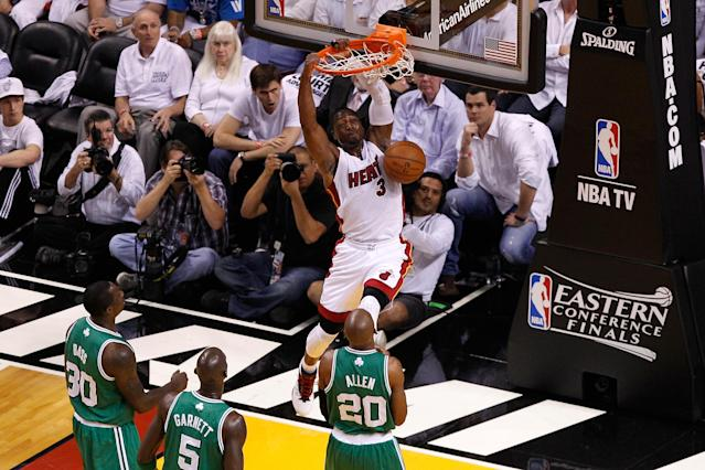 MIAMI, FL - JUNE 05: Dwyane Wade #3 of the Miami Heat dunks in the first half against the Boston Celtics in Game Five of the Eastern Conference Finals in the 2012 NBA Playoffs on June 5, 2012 at American Airlines Arena in Miami, Florida. NOTE TO USER: User expressly acknowledges and agrees that, by downloading and or using this photograph, User is consenting to the terms and conditions of the Getty Images License Agreement. (Photo by J. Meric/Getty Images)