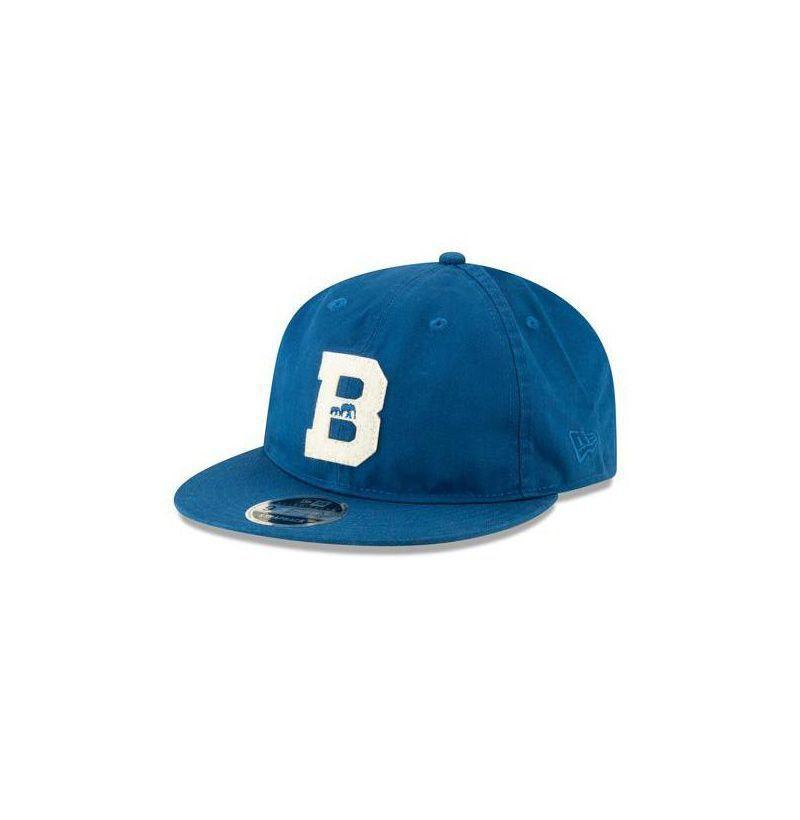 """<p><strong>The Brooklyn Circus</strong></p><p>thebkcircus.com</p><p><strong>$49.00</strong></p><p><a href=""""https://thebkcircus.com/collections/caps/products/bkc-x-new-era-felt-b-varsity-cotton-cap-seashore-blue"""" rel=""""nofollow noopener"""" target=""""_blank"""" data-ylk=""""slk:Buy"""" class=""""link rapid-noclick-resp"""">Buy</a></p><p>The easiest way to hide your messy mane if you haven't yet made time to hit a <a href=""""https://www.esquire.com/style/grooming/a32812028/getting-haircut-barber-shop-pandemic-safety/"""" rel=""""nofollow noopener"""" target=""""_blank"""" data-ylk=""""slk:barber"""" class=""""link rapid-noclick-resp"""">barber</a>. </p>"""