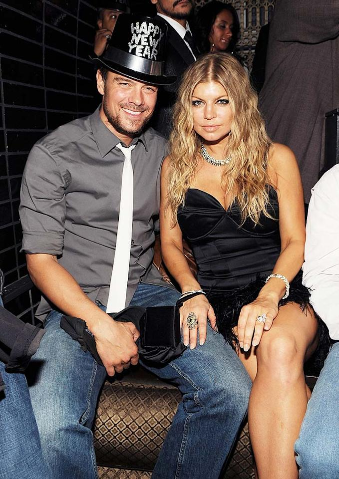 "Inside LAVO, Fergie took a breather from her hosting and performing duties with fiance Josh Duhamel. The two will wed in January. Denise Truscello/<a href=""http://www.wireimage.com"" target=""new"">WireImage.com</a> - December 31, 2008"