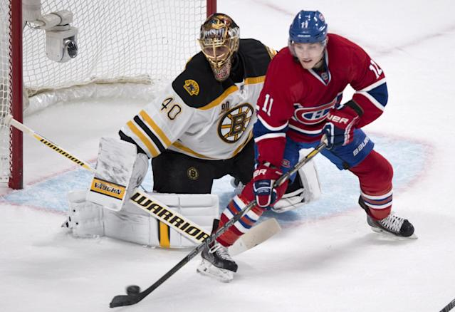 Montreal Canadiens' Brendan Gallagher tries to deflect a shot past Boston Bruins goalie Tuukka Rask during first period NHL hockey action Thursday, Dec. 5, 2013, in Montreal. (AP Photo/The Canadian Press, Paul Chiasson)